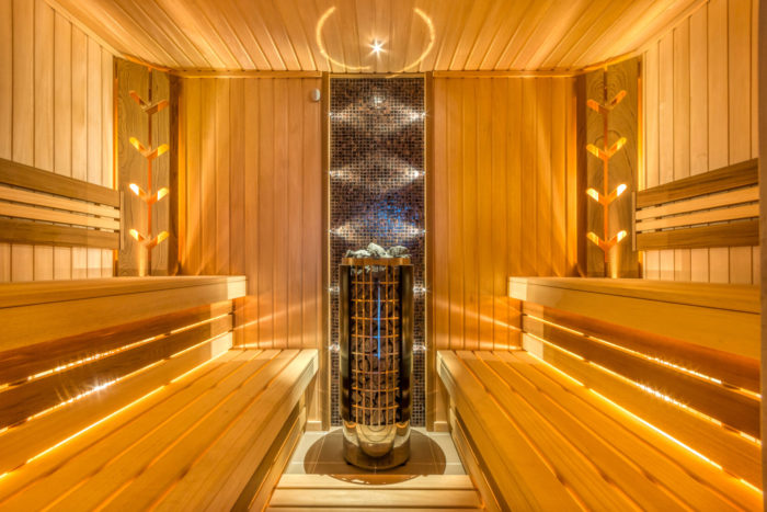 Perfect Sauna With Electric Heater, Wood Panel Walls And Beautiful Lighting